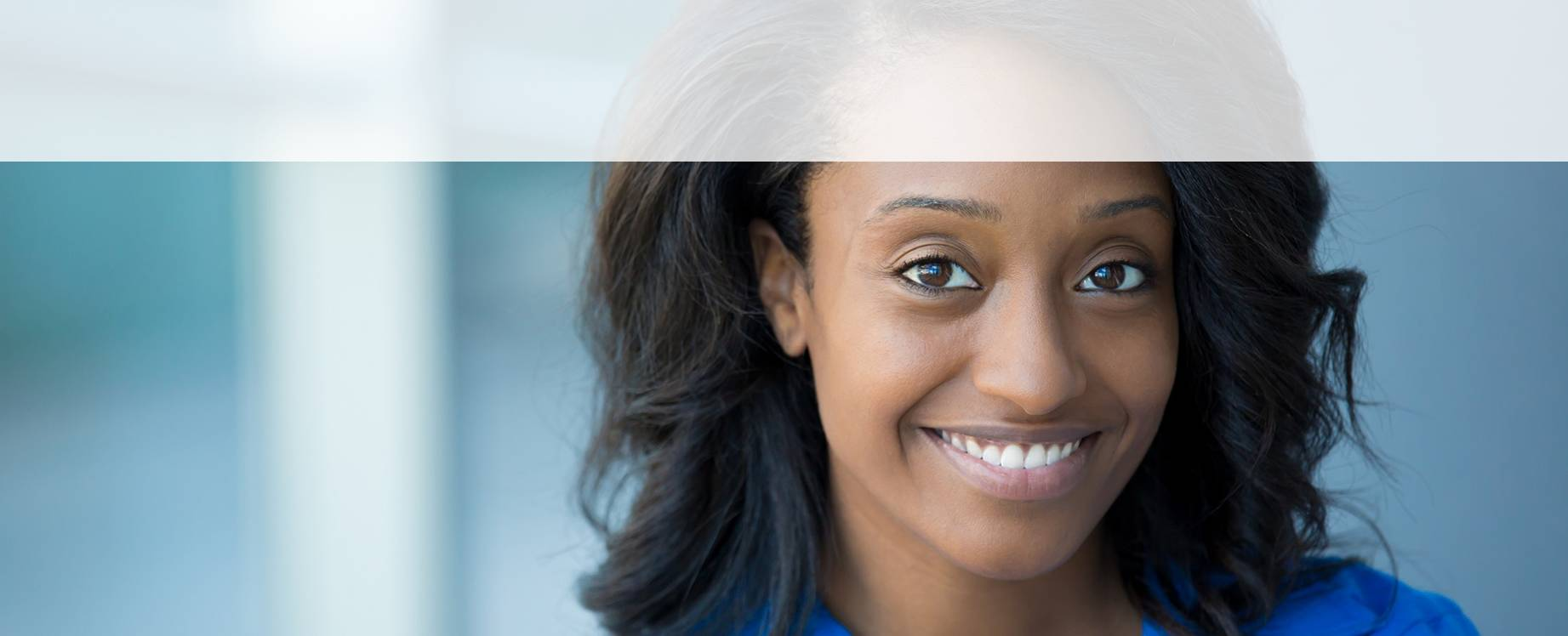 young professional woman smiling into camera